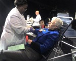 Joan Harless, COSI Team Member giving blood