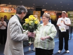 Roberta receives flowers for 5,000 hours of volunteer service.