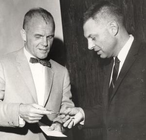 John Glenn purchases his COSI Membership from COSI executive director and founder Sandy Hallock, 1965